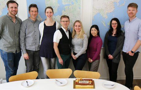 ASIMUT staff celebrating YSTCM as a new client